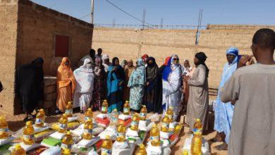 صورة كيهيدي: حزب التحالف الوطني يوزع مواد غذائية على السكان